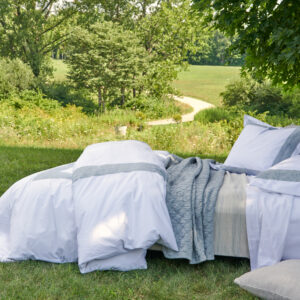 Cortina on bed with Louisa Mist Florence White Journey Blanket and Barrington pillows